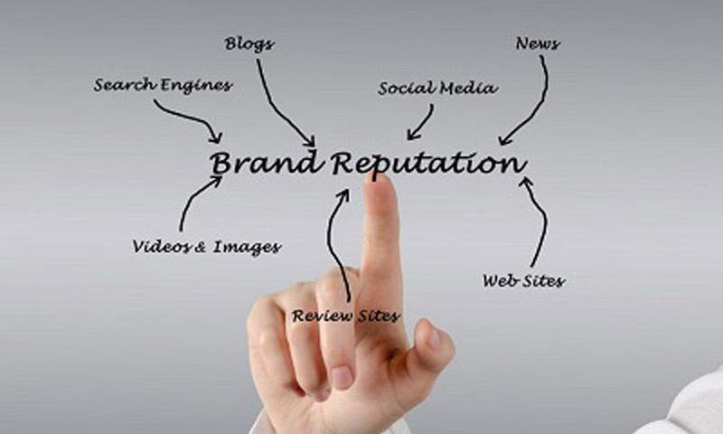 Hand pointing to brand reputation
