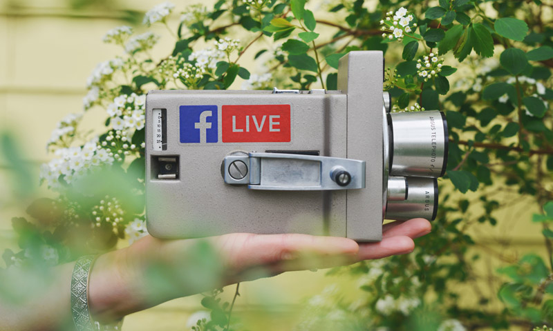 Video camera with Facebook Live logo